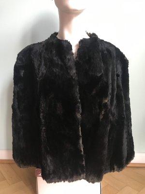 Manteau de fourrure noir-brun noir pelage