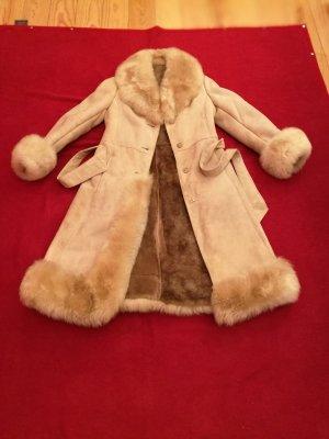 Manteau de fourrure crème cuir