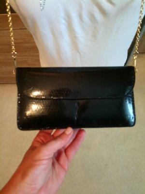 Bolso tipo pochette negro-color oro