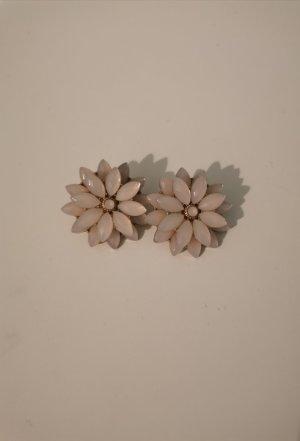 Boucle d'oreille incrustée de pierres rosé
