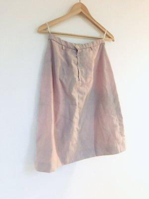 Falda de lino rosa empolvado