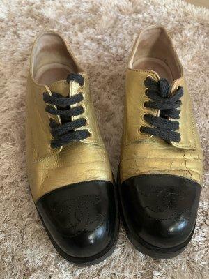 Chanel Chaussures à lacets noir-doré cuir