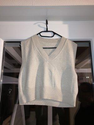 Sweter bez rękawów z cienkiej dzianiny kremowy