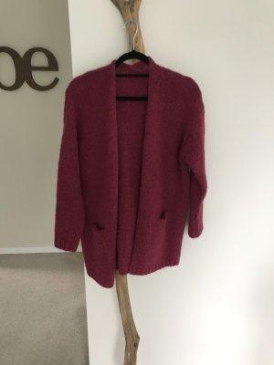 Veste tricotée en grosses mailles rouge framboise