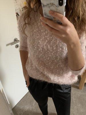 Weicher rosa Pullover