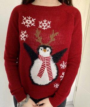 Weihnachtspullover mit Pinguin