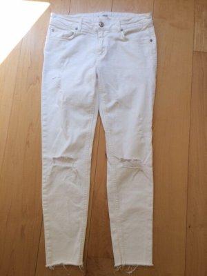 Weiße 7/8 Skinny Jeans mit Rissen