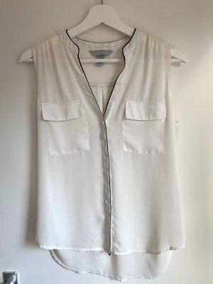 Weiße ärmellose Bluse mit V-Ausschnitt