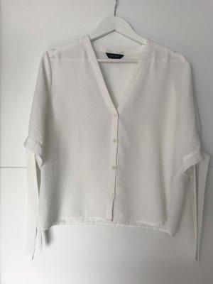 Weiße Bluse mit Bändern
