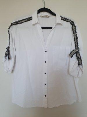 Weiße Bluse mit Details