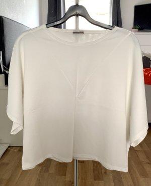 Weiße Bluse mit Fledermausärmeln