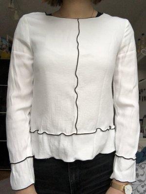 Weiße Bluse mit Highlight