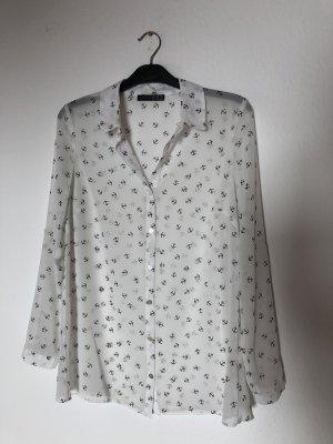 weiße Bluse mit kleinen schwarzen Ankern