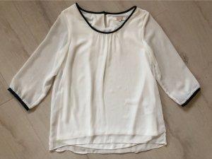 Weiße Bluse mit Lederimitat