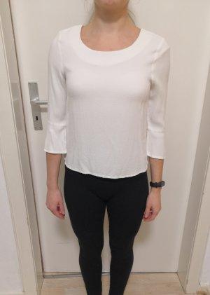 Weiße Bluse mit leichten Glockenärmeln