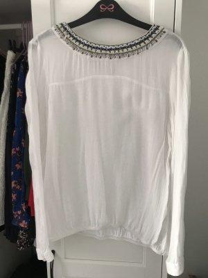 Weiße Bluse mit Perlenkragen