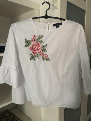 Weiße bluse mit rosen