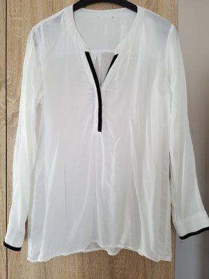 Weiße Bluse mit schwarzer Zierleiste