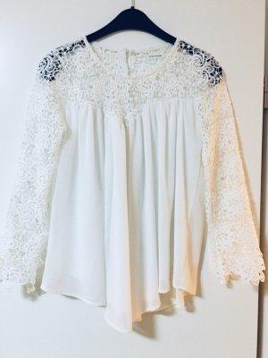 Weiße Bluse mit Spitzen