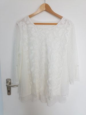 Weiße Bluse mit Stickereien