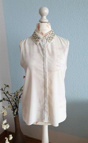 weiße Bluse ohne Ärmel mit Perlenkragen und Rückenausschnitt von Amisu
