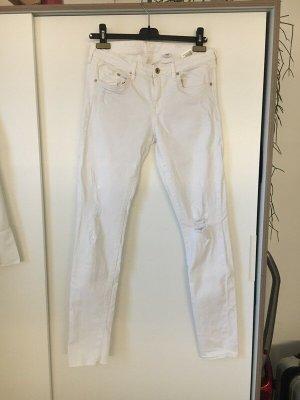 Weiße Jeans mit Löchern 30/32