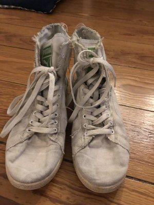 Weiße Puma-Sneakers