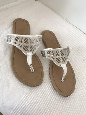 Atmosphere Sandalo toe-post bianco-argento