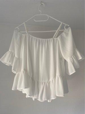 Blusa con volantes blanco