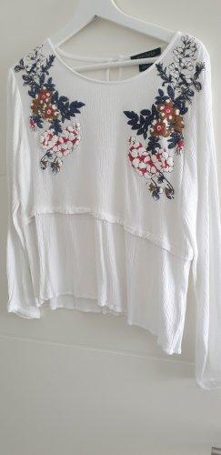 weiße Tunikabluse mit Muster