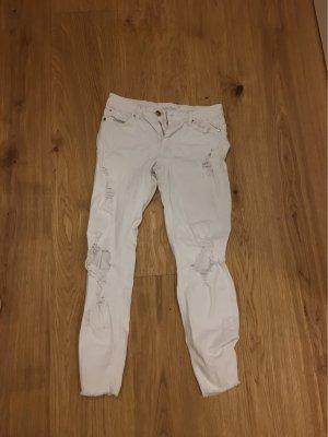 Weiße zerrissene Hose