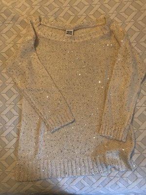 Weißer Pullover mit Pailletten