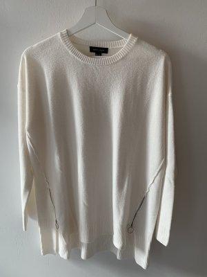Weißer Pullover mit Reißverschlüssen