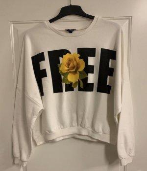 Weißer Pullover mit Schriftaufdruck