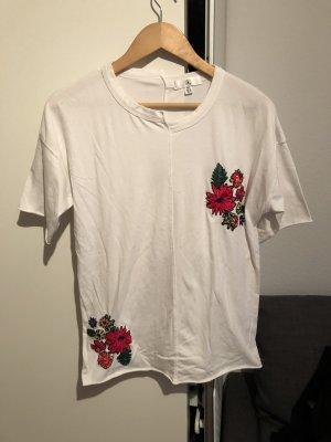 Weißes oversized shirt mit Applikationen