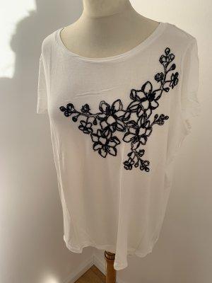 Weißes T-Shirt mit schwarzer Blumenstickerei
