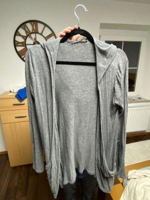 Chaleco con capucha gris claro