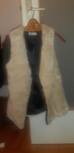 H&M Smanicato di pelliccia crema