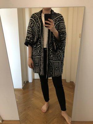 Manteau en tricot blanc-noir