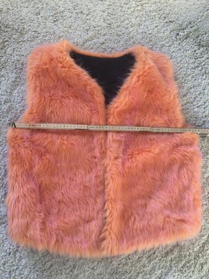 Gilet en fausse fourrure rose-orange