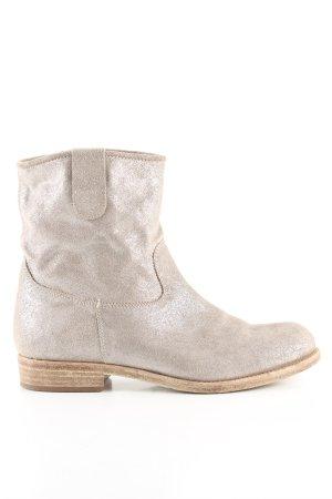 Botas estilo vaquero color plata look casual