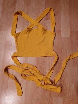 Blusa sin espalda amarillo
