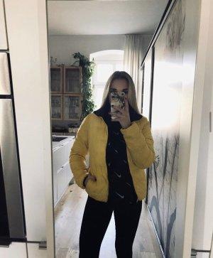 Chaqueta acolchada amarillo-negro