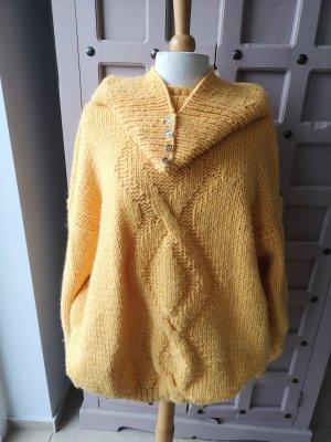 Wełniany sweter żółty