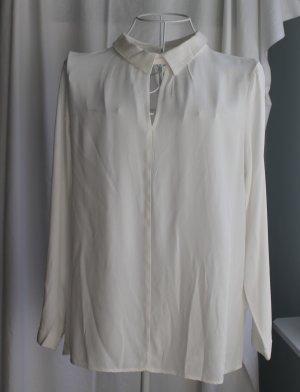 Wollweiße Shirtbluse mit kleinem Kragen
