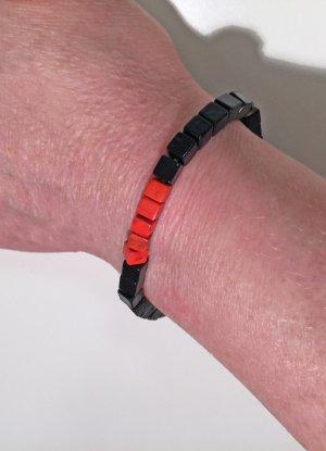 Würfel-Armband in schwarz-orange, 17 cm