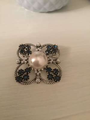 Broche blanco-azul