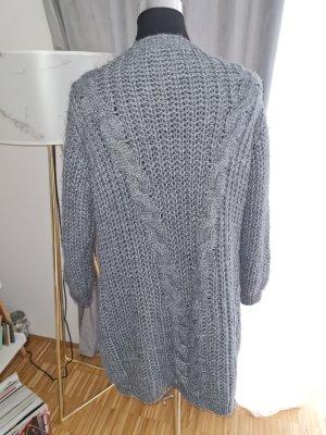 Veste tricotée en grosses mailles gris