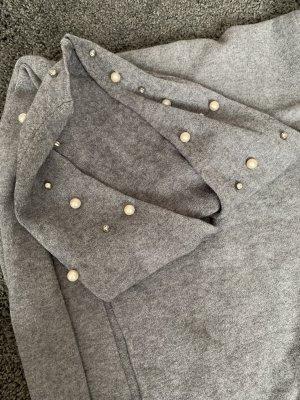 Pull tricoté gris clair