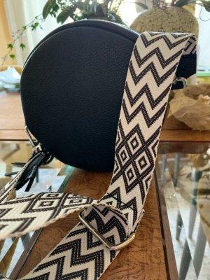 Wunderschöne schwarze Ledertasche rund mit 2 verschiedenen Riemen zum Umhängen